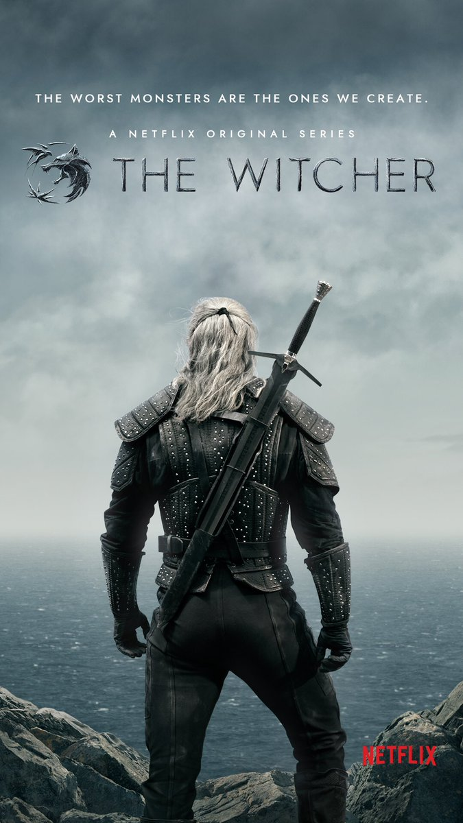 """back of man staring at horizon. title """"the witcher"""" above him"""